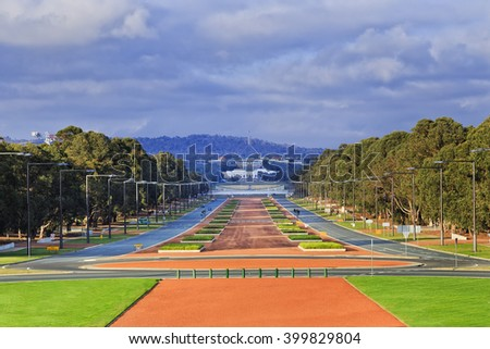 Perspective view along Anzac Parade in Australia's capital city Canberra on a sunny day. Modern city street from War Memorial to old and new Parliaments on Capital hill in government sector. - stock photo