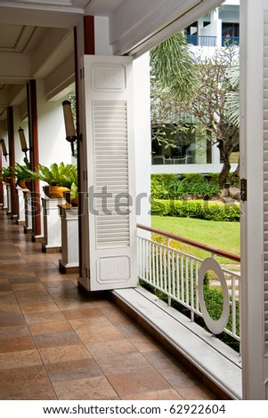 perspective view indoor walkway beside the green garden, Pattaya Thailand. - stock photo