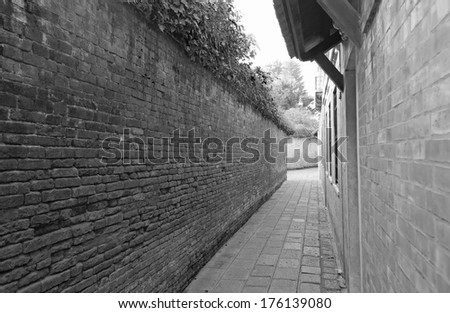 perspective view of a narrow corridor in black and white tone