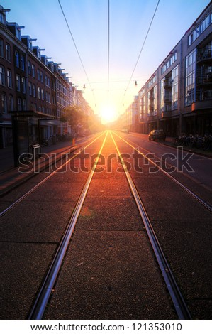 Perspective view of a railway in the streets of Amsterdam early in the morning