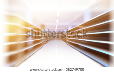 Perspective view of a shopping aisle with empty shelves in motion blur - stock photo