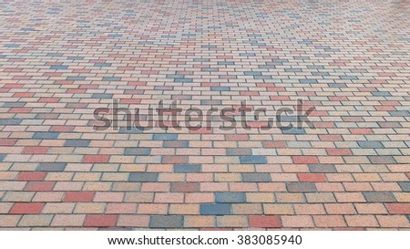 Perspective View of Colorful Brick Stone Street Road. Sidewalk, Pavement Texture Background - stock photo