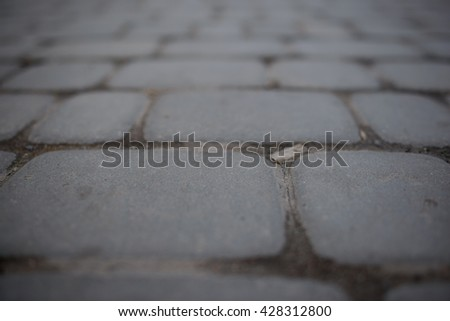 Perspective View of Monotone Gray Brick Stone Street Road. Sidewalk, Pavement Texture Background - stock photo