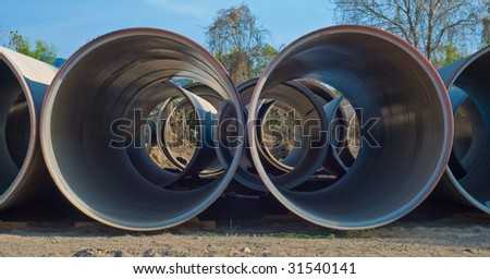 Perspective view of row of drainage pipes - stock photo