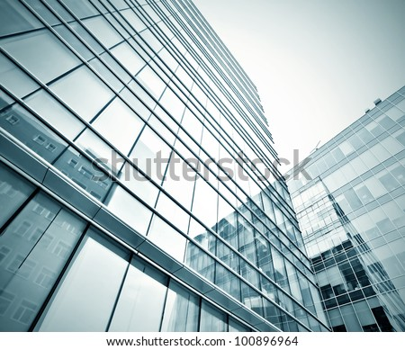 perspective view to dark high rise skyscrapers pane - stock photo