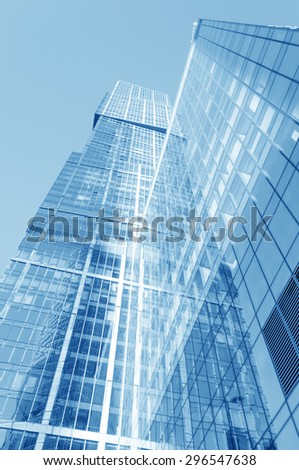 Perspective wide angle view to steel light blue glass surface, building skyscraper - stock photo