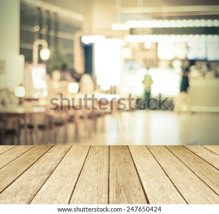 Perspective wood and blurred cafe with bokeh light background. product display template - stock photo