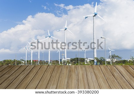 Perspective wood and Wind turbine background - stock photo