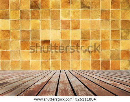 Perspective wooden floor with brick wall in background