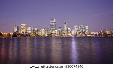 Perth, Australia - November 17, 2012: Perth CBD viewed at night reflected in the Swan River.
