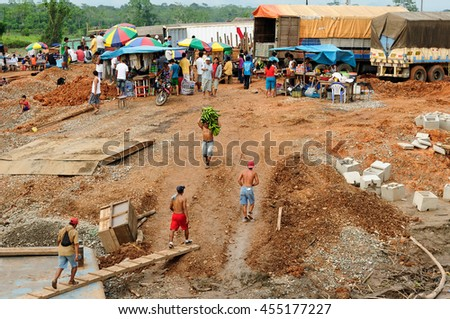 PERU, AMAZONIA - JUNE 02: Loading of the ship in a river port on the bank of the Amazon river in June 02, 2012