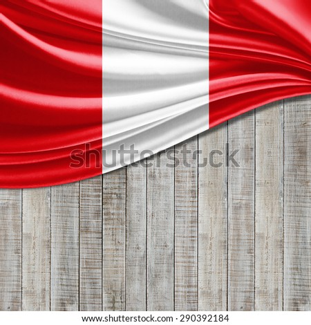 Peru flag of silk and wood background