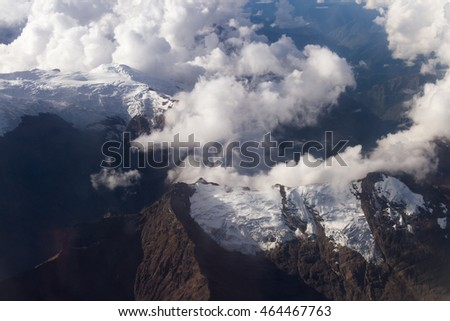 Peru - May 11 : Aerial view of the snow caped mountains of Peru from an Airplane flying from Lima to Cuzco. May 11 2016, Peru.