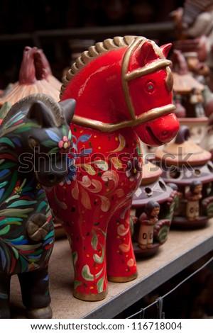 Peru traditional handcraft, ceramic colorfull horse - stock photo
