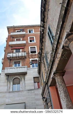 PERUGIA, ITALY- APRIL 22: MOdern and old buildings on April 22, 2011 in Perugia, Italy. Perugia hosts Jazz, Chocolate and Journalism festivals attracting many tourists each year. - stock photo