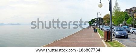 PERUGIA, ITALY - APRIL 19: Panoramic view of Lake Trasimeno on April 19, 2011 in Perugia,Italy. It's the largest lake on the Italian peninsula, part of the province of Perugia. - stock photo