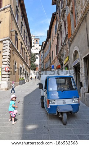 PERUGIA, ITALY- APRIL 22: Retro blue automobile on April 22, 2011 in Perugia, Italy. Perugia hosts Jazz, Chocolate and Journalism festivals attracting many tourists each year. - stock photo
