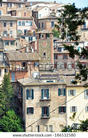 PERUGIA, ITALY- APRIL 22: Roofs of the town on April 22, 2011 in Perugia, Italy. Perugia hosts Jazz, Chocolate and Journalism festivals attracting many tourists each year. - stock photo