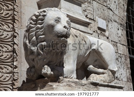Perugia. Italy. Lion sculpture on the facade of the building.
