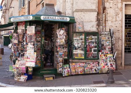 Perugia, Italy, May 13, 2013. Newspaper and magazine vendors stall , Perugia, Italy - stock photo