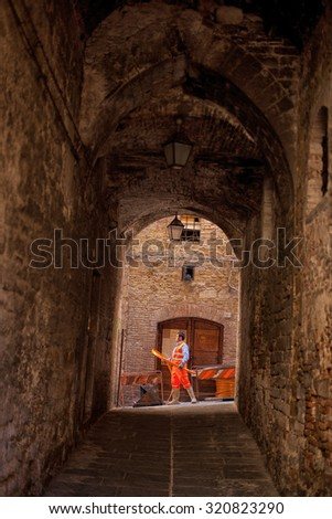 Perugia, Italy, May 13, 2013. Workman laying electrical cable in the old township of Perugia, Italy