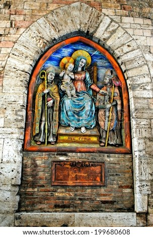 PERUGIA, ITALY - OCTOBER  2010: Outdoor fresco on wall of a medieval building. Umbria, central Italy.  - stock photo