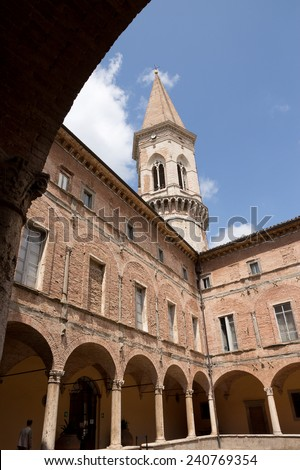 PERUGIA - JULY 25: San Pietro cloister and the campanile on  July 25, 2014 in Perugia, Italy. The Benedictine abbey of Saint Pietro is a prestigious monastic foundations in central Italy.  - stock photo