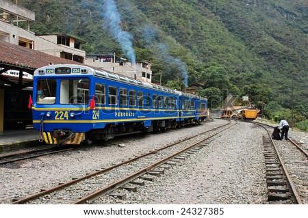 PeruRail at Aguas Calientes Station (Machu Picchu, Peru) - stock photo