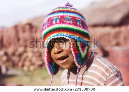 Peruvian boy with chullo - stock photo