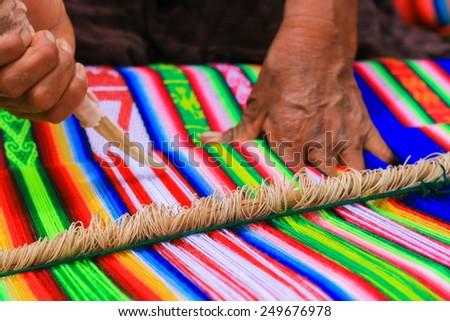 peruvian cloth green blue white multicolor traditional - stock photo