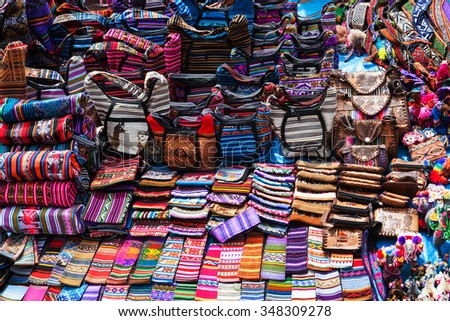 peruvian clothes and bags on the market - stock photo