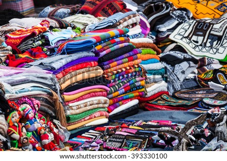 peruvian clothes and toys on the market - stock photo
