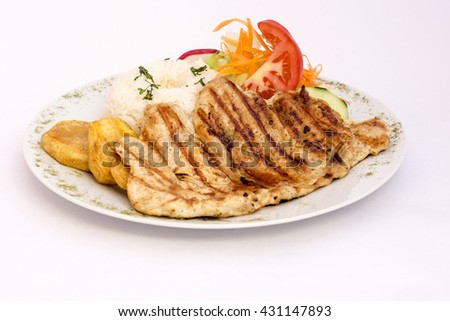 Peruvian Dish: chicken grilled with rice and salad.