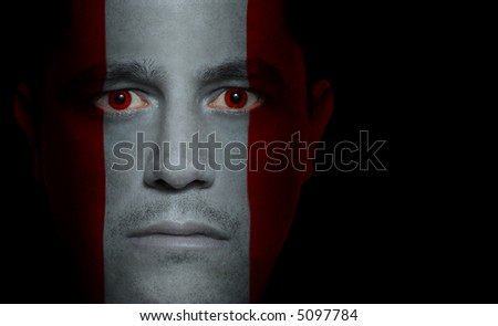 Peruvian flag painted/projected onto a man's face.