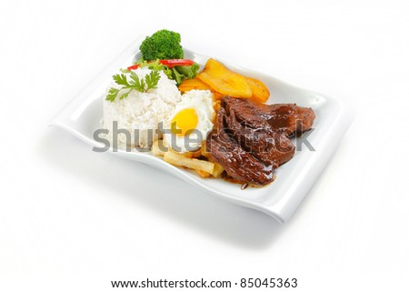 "Peruvian  food beef, whit potatoes, egg, and rice. ""Lomo a lo pobre"" - stock photo"