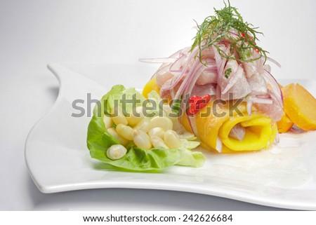 Peruvian Food: Causa and Cebiche dish. - stock photo