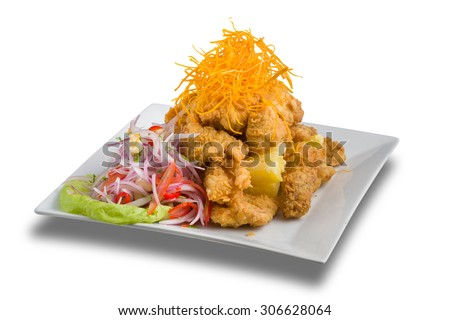 Peruvian food: chicharrones de pescado, a fried fish dressed with onions and pepper. - stock photo
