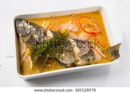 Peruvian food: Sudado de pescado, fish soup. - stock photo