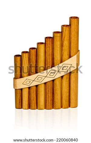 Peruvian Pan Flute wooden light brown color isolated on a white background - stock photo