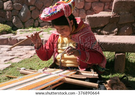 Peruvian people in traditional clothes near Cusco, Peru, July 16, 2009