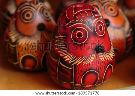 """Peruvian traditional handcraft: """"Mate burilado"""" a fruit carved work. - stock photo"""