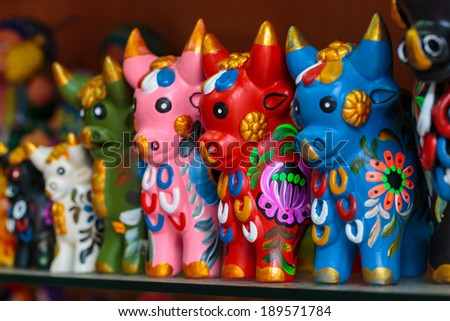 Peruvian traditional handcraft: Torito de Pucara, colorfull ceramic bulls - stock photo