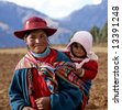 Peruvian Woman and Baby in Native Clothing in Sacred Valley Peru - stock photo