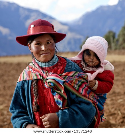 Peruvian Woman and Baby in Native Clothing in Sacred Valley Peru
