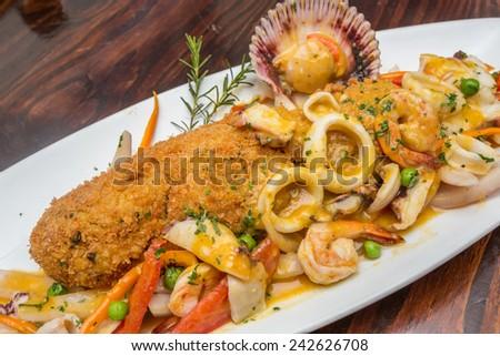 PERUVIIAN FOOD, Tacu tacu with seafood sauce, - stock photo