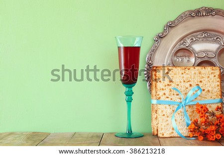 Pesah celebration concept (jewish Passover holiday) with wine and traditional plate - stock photo