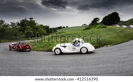 Pesaro, Italy - May 15, 2015: BMW 328 1937  in unidentified crew on an old racing car in rally Mille Miglia 2015 the famous italian historical race (1927-1957) - stock photo
