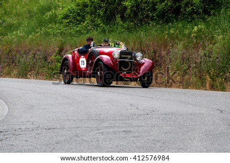 Pesaro, Italy - May 15, 2015: FIAT 514 CA Spider Sport 1931 in nidentified crew on an old racing car in rally Mille Miglia 2015 the famous italian historical race (1927-1957)