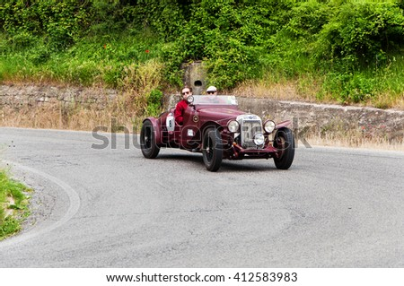 Pesaro, Italy - May 15, 2015: O.M. 665 SS MM Superba 2200 1930  in nidentified crew on an old racing car in rally Mille Miglia 2015 the famous italian historical race (1927-1957)