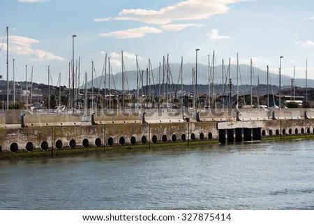 Pescara Harbor with Majella in the background - stock photo